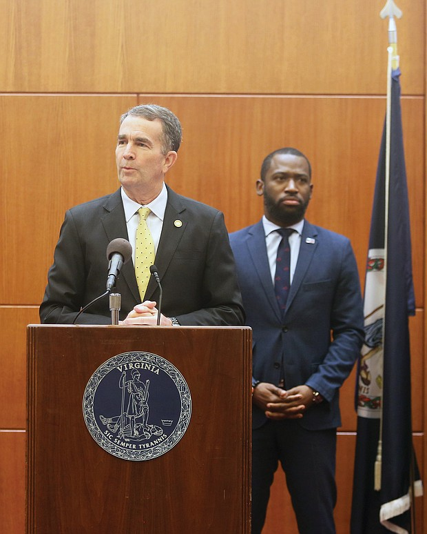Gov. Ralph S. Northam offers the latest information on the coronavirus and its impact in the state during a news conference Wednesday at the Patrick Henry Building. At the briefing, the governor's second in a week, he was surrounded by a bevy of state health, hospital and other officials, including Mayor Levar M. Stoney.