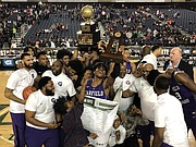 Seattle's Garfield High School boys basketball team celebrates after winning the Washington state 3A championship by beating O'Dea, 69-44 last Saturday, March 7 at the Tacoma Dome.