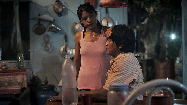 """A woman takes the pulse of a man in """"The Fever,"""" a moving film that looks into the experiences of indigenous people in Brazil. The film plays again on Friday, March 13 as part of the Portland International Film Festival."""