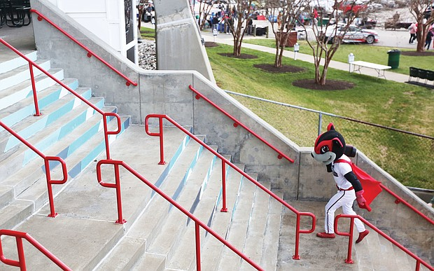 Signs of spring abound, from robins to daffodils to baseball. Here, Nutzy, the mascot of the Richmond Flying Squirrels, climbs the steps of The Diamond baseball stadium to kick off the team's first event of its 11th season — a block party last Saturday at the stadium on Arthur Ashe Boulevard. Nutzy's Block Party included live music, dancing, local vendors and ballpark tours. It was the first opportunity for fans to buy game tickets before the season home opener on Thursday, April 16, against the Bowie Baysox of Maryland. The Richmond Flying Squirrels are the Double-A affiliate of the San Francisco Giants.
