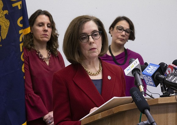 Oregon should prepare for thousands of cases of coronavirus, Gov. Kate Brown said Thursday as she announced a ban on ...