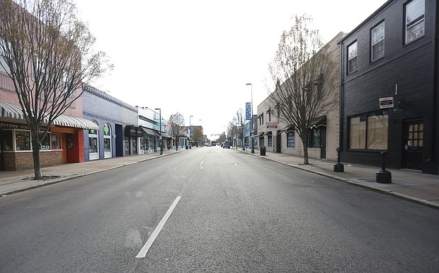 Carytown looks deserted Tuesday morning. This stretch of Cary Street between Belmont and Sheppard streets, is typically filled with cars. Due to the coronavirus pandemic and requirements for social distancing, this is the new normal for retail districts around the country and the world.