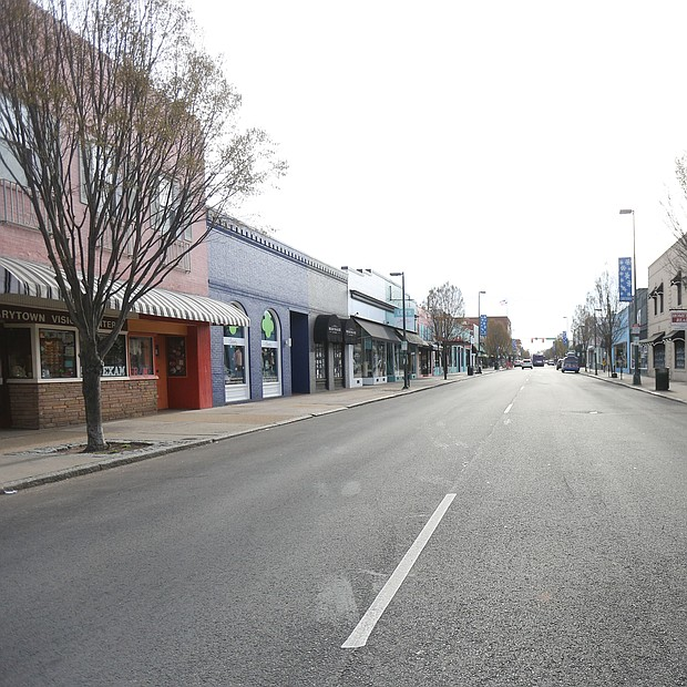 Carytown looks deserted Tuesday morning. This stretch of Cary Street between Belmont
