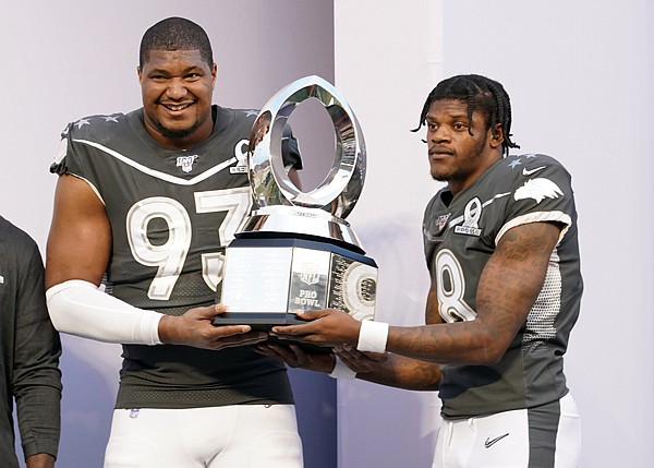 Calais Campbell has agreed to a two-year, $27 million contract extension with the Baltimore Ravens after a trade with the Jacksonville Jaguars for a fifth-round pick in the 2020 NFL Draft. (Above) The 2020 Pro Bowl Defensive MVP Calais Campbell and Offensive MVP Lamar Jackson holding the MVP trophy.
