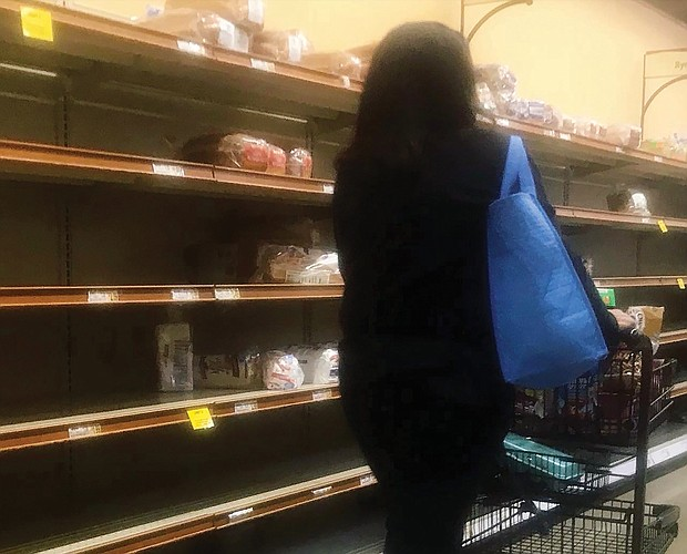 """Shelves are bare in area grocery stores across the city and beyond Friday. """"This is like a Christmas rush on steroids, yet at Christmas we are prepared for the crowds and long lines,"""" one shopper commented."""