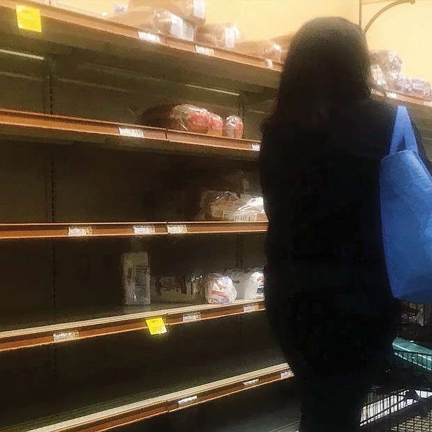 "Shelves are bare in area grocery stores across the city and beyond Friday. ""This is like a Christmas rush on steroids, yet at Christmas we are prepared for the crowds and long lines,"" one shopper commented."