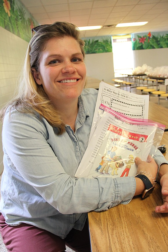 Kate Johnson had a difficult time finding where to pick up food at Chimborazo Elementary School on Monday.