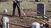 Dr. John Slavin gets ready for more weed whacking at private Woodland Cemetery in Henrico County. He has been volunteering every Sunday for 18 months to help clear overgrown grass, vines and trees and restore the historic, private African-American cemetery that dates to 1916.