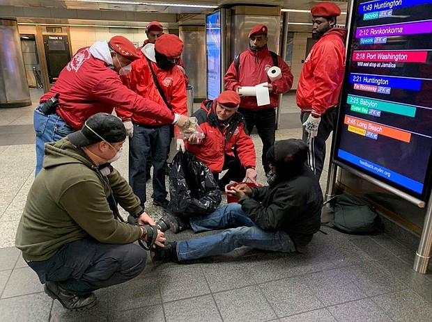 The Guardian Angels hand out care packages, stuffed with a sandwich, fruit snacks, hand wipes, water, and peanut butter crackers to NYC's homeless