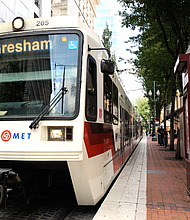 TriMet continues run buses and trains during the coronavirus pandemic, but only wants people to take transit if necessary in order to slow the spread of the disease.  By keeping service going, TriMet wants to make space for medical staff, first responders and other essential staff that serve the community and count on TriMet to get where they need to go. (Photo by Tim Adams/Wikipedia Commons)