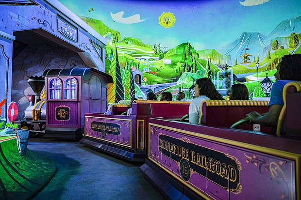"""Guests board Runnamuck Railroad and journey into Runnamuck Park as part of Mickey & Minnie's Runaway Railway, opening March 4, 2020, in Disney's Hollywood Studios at Walt Disney World Resort in Lake Buena Vista, Fla. The first ride-through attraction in Disney history featuring Mickey Mouse and Minnie Mouse brings guests into the vibrant world of """"Mickey Mouse"""" cartoon shorts."""
