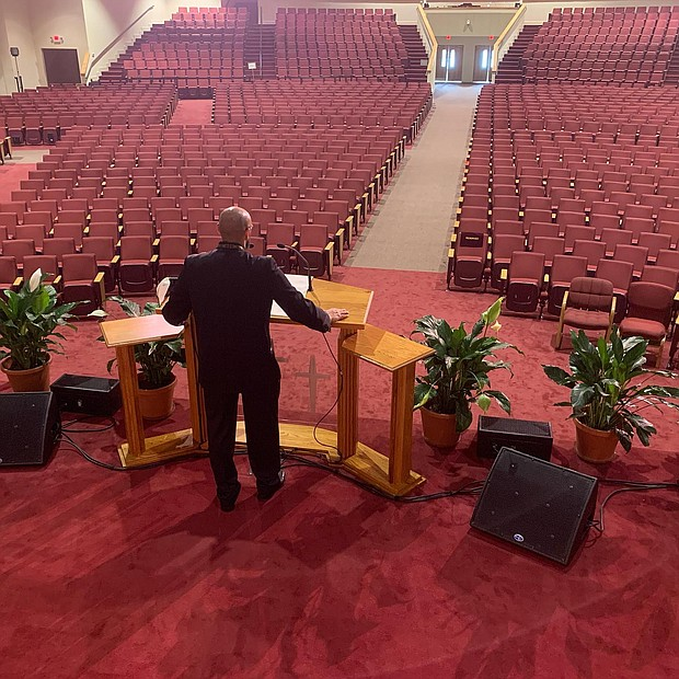 Mount Moriah Missionary Baptist Church Senior Pastor Rev. Dr. Byron Benton delivers a Sunday sermon to an empty sanctuary during a live streamed service in North Charleston, S.C.