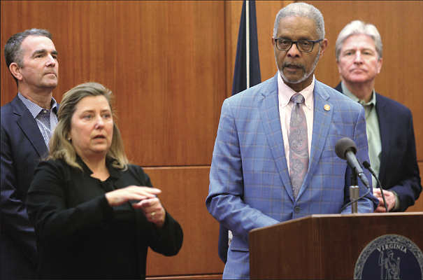 Dr. M. Norman Oliver provides updates on Virginia's response to the spread of coronavirus as Gov. Ralph S. Northam, left, looks on. Location: The Patrick Henry Building at Capitol Square on March 18 during Gov. Northam's daily briefing for reporters.
