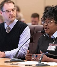 Ebony Clarke (right), director of the Multnomah County Mental Health and Addiction Services Division, addresses a meeting last fall of county commissioners. Clarke and other county workers in mental health are reaching out to the local community with helpful information on coping with anxiety in the face of the current coronavirus pandemic (COVID-19).   (Photo courtesy Multnomah County)