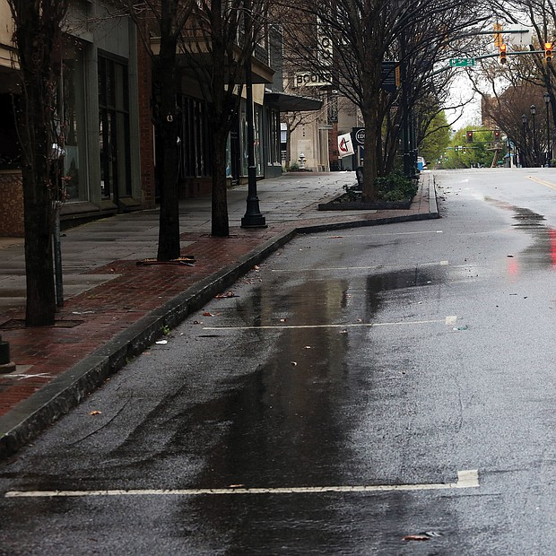 The 500 block of East Grace Street in Downtown is deserted, with similar desolate landscapes across the area as people stay home.