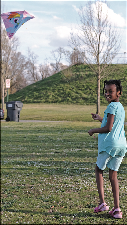 With school out and a breeze blowing, Noelle Sharp, 9, takes advantage of a sunny day to
