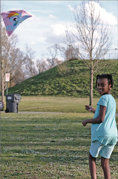 With school out and a breeze blowing, Noelle Sharp, 9, takes advantage of a sunny day to fly a kite last Friday in Byrd Park. The youngster was with her family at the park, the wide open spaces allowing for social distancing and fun.