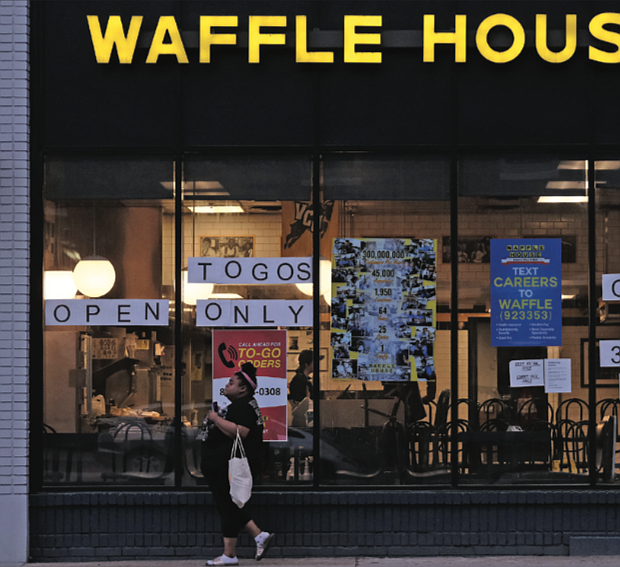The Waffle House at 1309 W. Broad St. advertises it's only offering carry-out service in obedience of Gov. Ralph S. Northam's executive order this week allowing restaurants to offer only take-out, curbside or delivery service.