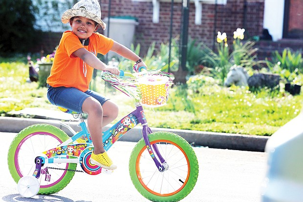 Everyone needs a break outdoors, particularly during this time of pandemic and orders to stay home and away from people. Rose Mukami Bartosh, 4, rolls along on her colorful bike, with her mom, Muthoni Imungi, not far behind last Sunday. The pair was spotted in the 3400 block of Fendall Avenue near Westwood Avenue in North Side.