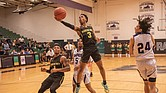 Jordan Parham of Huguenot High School goes up for a basket during the Falcons' game against James River High School on Feb. 7.