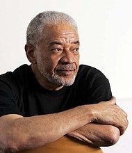 "Singer-songwriter Bill Withers poses in office in this 2006 photo.  Withers, who wrote and sang a string of soulful songs in the 1970s that have stood the test of time, including ""Lean On Me,"" ""Lovely Day"" and ""Ain't No Sunshine,"" died in Los Angeles from heart complications on Monday, March 30. He was 81."