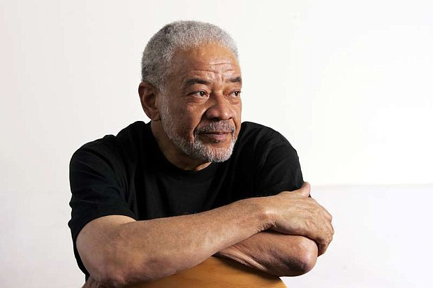 """Singer-songwriter Bill Withers poses in office in this 2006 photo.  Withers, who wrote and sang a string of soulful songs in the 1970s that have stood the test of time, including """"Lean On Me,"""" """"Lovely Day"""" and """"Ain't No Sunshine,"""" died in Los Angeles from heart complications on Monday, March 30. He was 81."""