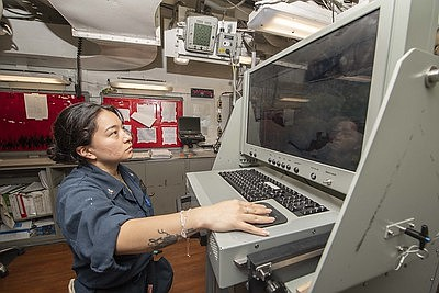 Gas Turbine System Technician (Electrical) 2nd Class Carina Valle, from Houston, operates an integrated computer assessment system during maintenance aboard ...