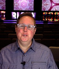 Pastor Matt Summers of Crossroads Christian Church in Joliet on Tuesday records his online service for Easter Sunday.