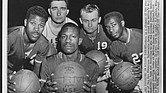 The University of San Francisco's starting lineup: Bill Russell, seated front center; and left to right, K.C. Jones, Mike Farmer, Carl Boldt and Hal Perry.