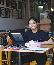 Czarina Deguzman sits in the doorway of Soul Taco to take to-go orders. The restaurant on 2nd Street is one of Soul Taco's two locations in Downtown.