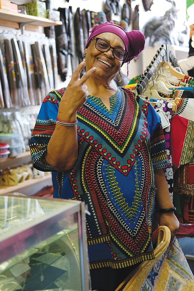 Mahasin Shakoor, owner of Shakoor's Merchandise, is happy to be open for business using social distancing guidelines, which are posted on her door.