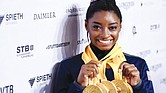 Championship gymnast Simone Biles shows off gold medals won at the 2019 World Games in Stuttgart, Germany.