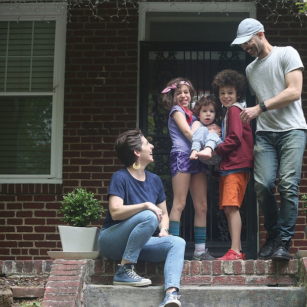 """Ellie and Kwan Burke, and their children, twins Anoushea and brother Kofi, 9, who are holding 2-year-old Nico, are enjoying time together on the front steps of their home in The Fan. """"Though it took about four weeks into self-quarantining to find, this time has allowed us all to determine our own rhythm to our days and our lives,"""" the Burkes said. """"As a result, we've dropped much deeper into our relationships with one another and have felt a richness we've never experienced before."""""""