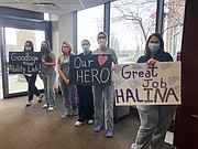 Staff members at Silver Cross Hospital cheer on Halina Zabinski as she was released from the hospital after a five-week stay. She was the hospital's first COVID-19 patient.