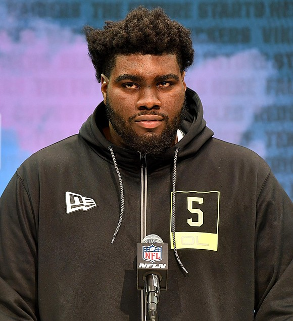 Ten players had already been chosen. NFL commissioner Roger Goodell, the host of the NFL Draft, had already given his ...