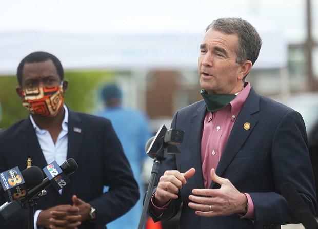 Mayor Stoney listens to Gov. Northam speaking