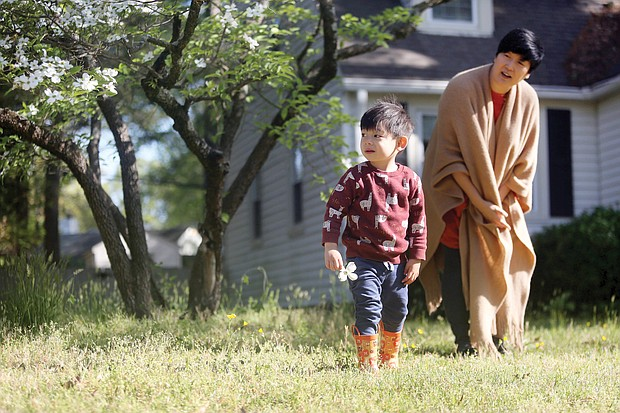 """Sarah Choi gets to spend more time with her son, Maximino Guertler Choi, at their Lakeside home in Henrico County without the interruption of day care. The 46-year-old marketing consultant sees that as her silver lining during this time. Her son, she said, is 21⁄2 and exploding with new words and expressions each day. """"It's amazing to be the first person to witness his progress,"""" she said."""