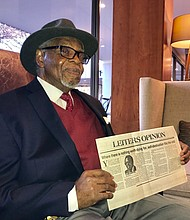 Dr. E. Lee Lassiter holds a copy of his column featured in the September 23, 1985 edition of The News American. In 1965, Dr. Lassiter became the second African American to be hired by the paper in the Editorial department. The retired journalist and former Coppin State University college professor graduated from Tuskegee Institute (now Tuskegee University) in 1959 with a B.S. degree in Secondary Education. He received an M.S. in Journalism from Boston University in 1963. He would later earn a doctorate from Morgan State University in 1994