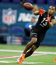 Former Texas wideout Devin Duvernay was drafted by the Baltimore Ravens in the fifth round of the 2020 NFL Draft. Ravens General Manager Eric DeCosta says Duvernay's style of play somewhat reminds him of Steve Smith Sr. (Above) Duvernay at the 2020 NFL Scouting Combine.