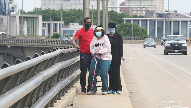 """Corrine V. """"Coco"""" McClaine starts on her birthday walk April 29 with her son, Scott B. McClaine, and her daughter, Dr. Arvid A. McClaine. Location: The Lee Bridge. The Virginia War Memorial is in the background."""