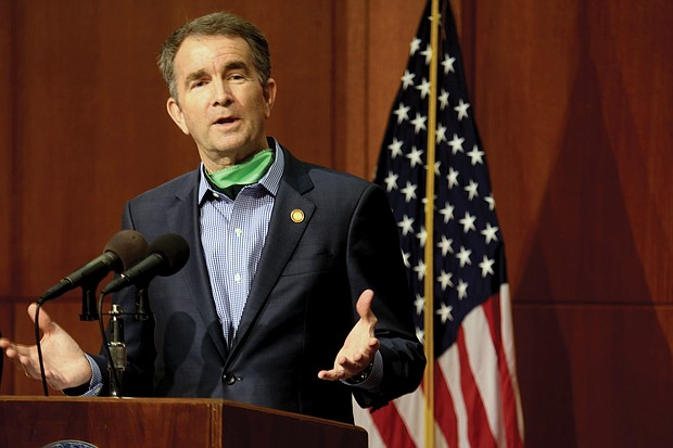 Gov. Ralph S. Northam notes that COVID-19 invaded the state two months ago as he updates reporters on the plan for reopening businesses at a news conference Wednesday. He also saluted nurses in honor of National Nurses Day and praised the soldiers in the Virginia National Guard for their work to combat the disease.