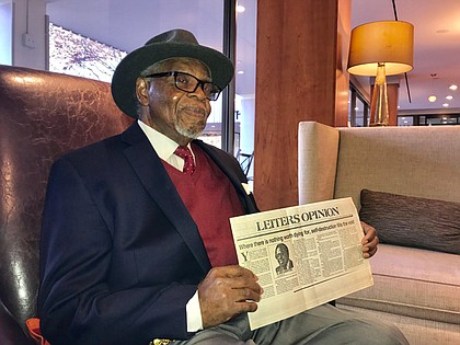Dr. E. Lee Lassiter holds a copy of his column featured in the September 23, 1985 edition of The News American. In 1965, Dr. Lassiter became the second African American to be hired by the paper in the Editorial department. The retired journalist and former Coppin State University college professor graduated from Tuskegee Institute (now Tuskegee University) in 1959 with a B.S. degree in Secondary Education. He received an M.S. in Journalism from Boston University in 1963. He would later earn a doctorate from Morgan State University in 1994.