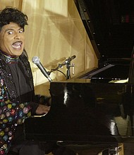 """Little Richard, the self-proclaimed """"architect of rock 'n' roll,"""" performs during a 2001 birthday celebration for legendary entertainer Milton Berle. Richard's hyperkinetic piano playing, coupled with his howling vocals and hairdo, made him an implausible sensation — a gay, black man celebrated across America during the buttoned-down Eisenhower era. He died Saturday at the age of 87.  (AP photo)"""