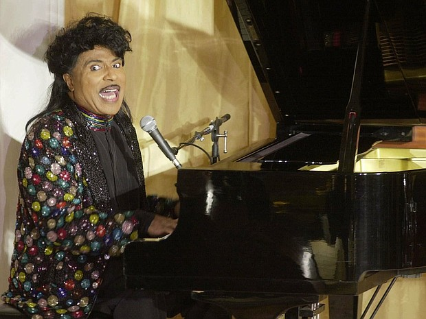 "Little Richard, the self-proclaimed ""architect of rock 'n' roll,"" performs during a 2001 birthday celebration for legendary entertainer Milton Berle. Richard's hyperkinetic piano playing, coupled with his howling vocals and hairdo, made him an implausible sensation — a gay, black man celebrated across America during the buttoned-down Eisenhower era. He died Saturday at the age of 87.  (AP photo)"