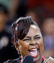 Singer Betty Wright performs the national anthem in 2013 before an NBA basketball game in Miami. The Grammy-winning soul singer and songwriter died of cancer at her home in Miami on Sunday. (AP photo)
