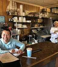 Joy Sinviengxay manages the counter at the Chai Thai restaurant in east Portland, one of two eateries providing meals to homeless shelters operated by Human Solutions as part of a partnership with two nonprofits providing financial backing to businesses impacted by the coronavirus health crisis.