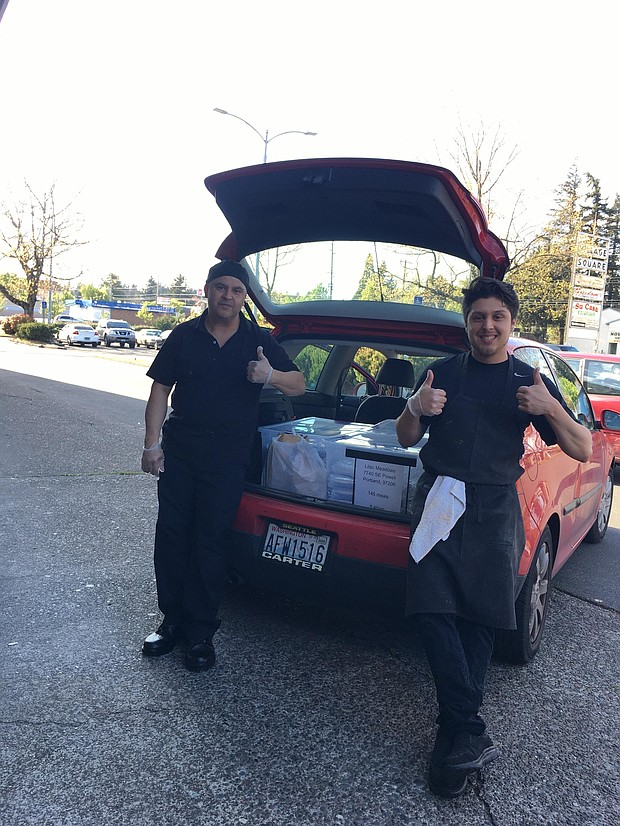 Salvador Arreola  and Oscar Ocampos of Nelly's Taqueria in east Portland prepare weekly dinners for the residents of Human Solutions' two emergency shelters, Lilac Meadows for Families and the Gresham Women's Shelter.