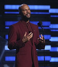 Common on stage during the Jan. 26 Grammy Awards in Los Angeles . The Academy Award-winning rapper and his criminal justice reform organization Imagine Justice has launched a campaign calling attention to the threat coronavirus poses on millions of people jailed or imprisoned in the U.S.  (AP photo)
