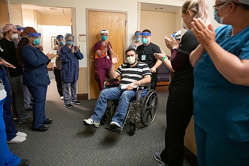 """AAMC Celebrates 300th Discharged Coronavirus Patient Milestone Annapolis— On Wednesday, May 13, 2020, caregivers at Anne Arundel Medical Center (AAMC) formed a 'clap line' to celebrate the discharge of José Portillo. After a five-day stay, the 33-year-old from Annapolis is the medical center's 300th discharged coronavirus patient. """"We are celebrating the courage and strength of José and all 300 patients to-date who have been discharged,"""" said Sherry Perkins, president of AAMC. """"In witnessing this celebratory moment for our patient, I am deeply grateful to all of our care teams who are working tirelessly for these life-saving victories."""""""