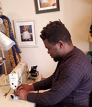 Abiodun Soluade is the lead tailor who makes masks. The $12-$25 creations for men, women and children ages two to eight are eye-catching and unique.